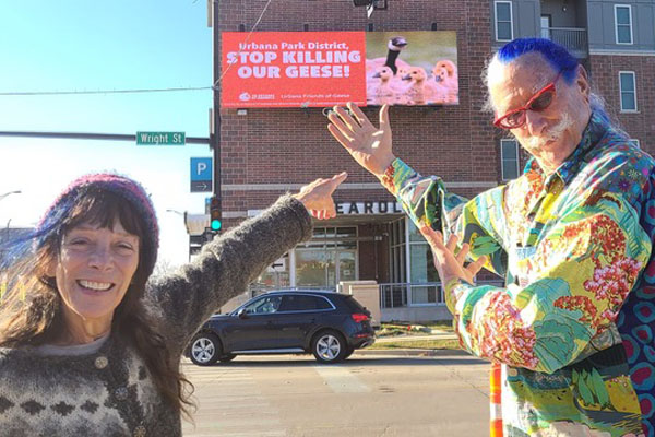 Dr. Susan Parenti and Dr. Patch Adams led the flashmob on Saturday. They are encouraging members of the public to take selfies with the billboard at Wright Street and University Avenue and tag Urbana Parks District on social media. Photo: Derek Busby